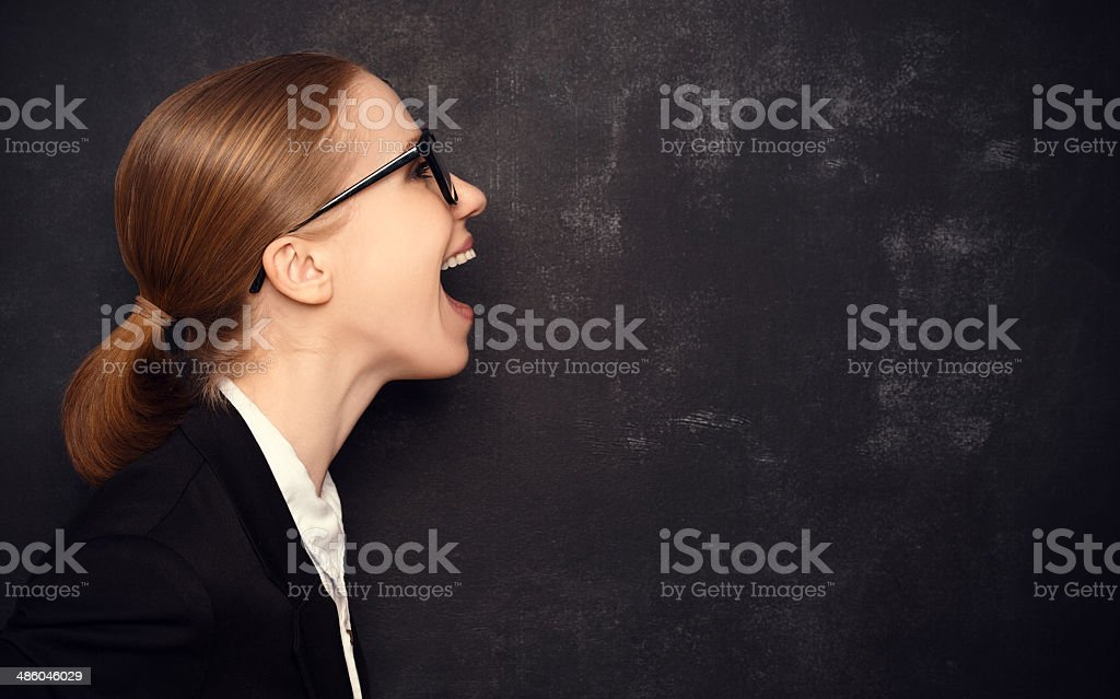 Concept woman in glasses said at a blank blackboard royalty-free stock photo