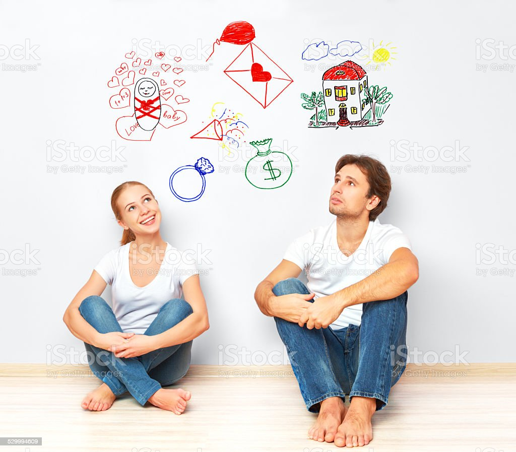concept. young couple dreaming of new house, child, financial well-being stock photo