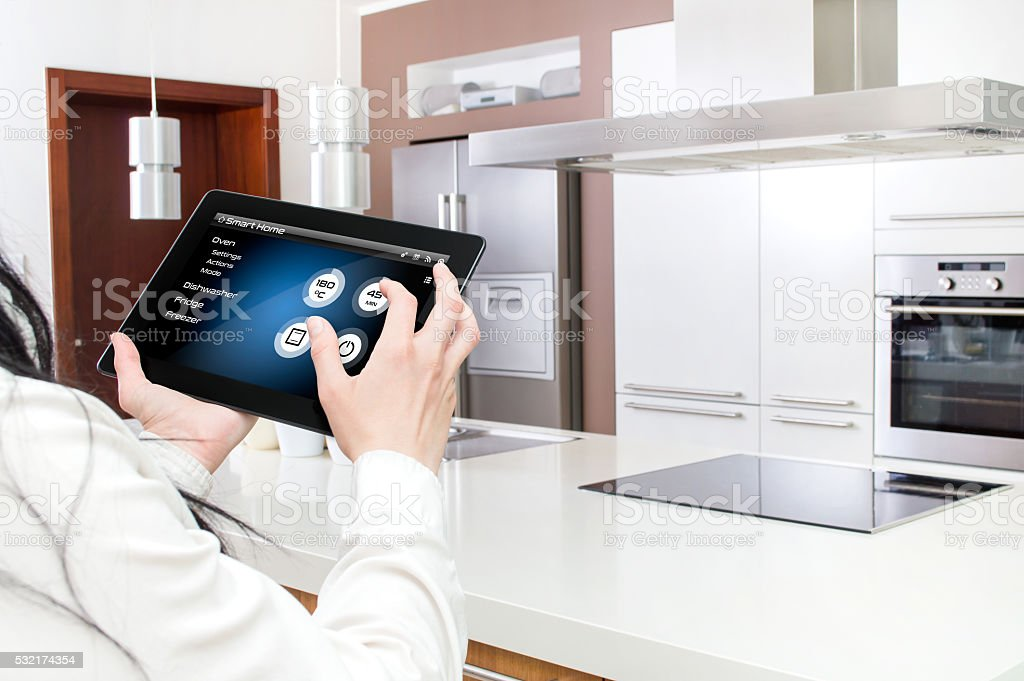 Conception of smart kitchen controlled by tablet application. stock photo