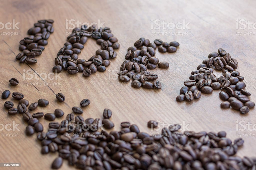 Conceptional sign IDEA drawn among brown roasted coffee beans stock photo