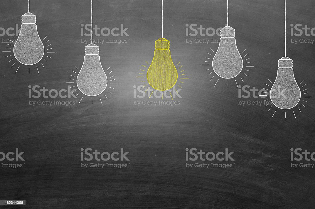 New Idea light bulb in blackboard stock photo