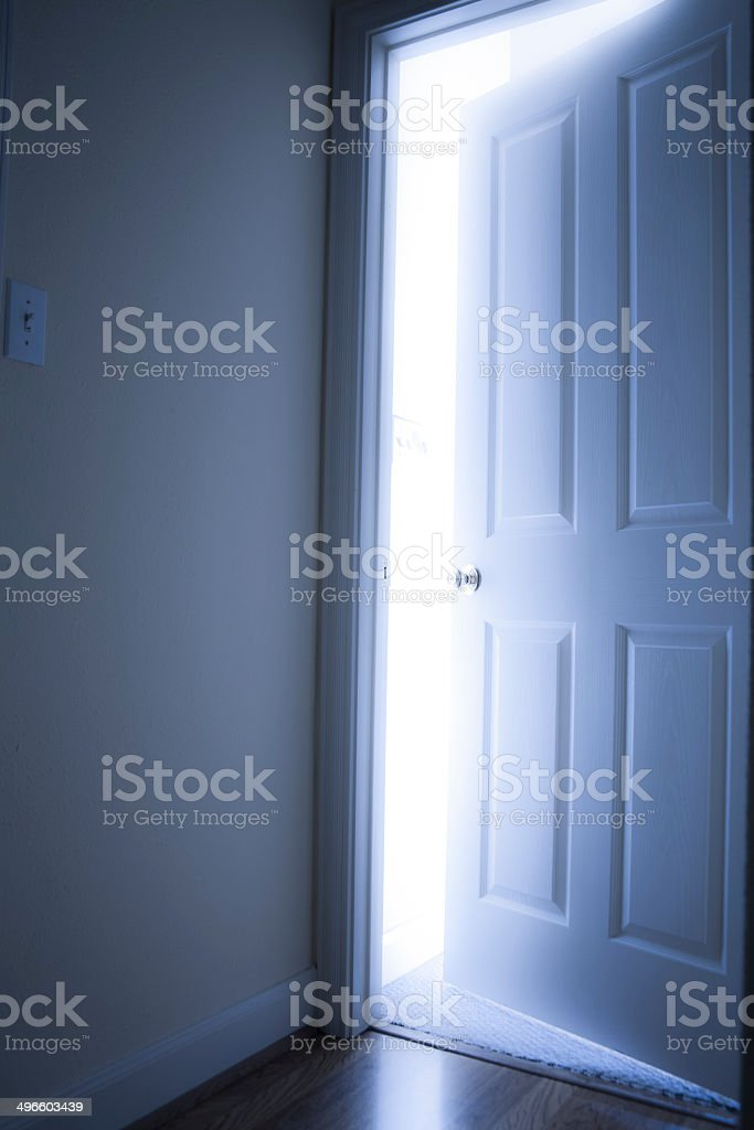 Concepts: Open door with bright light from the other side. stock photo