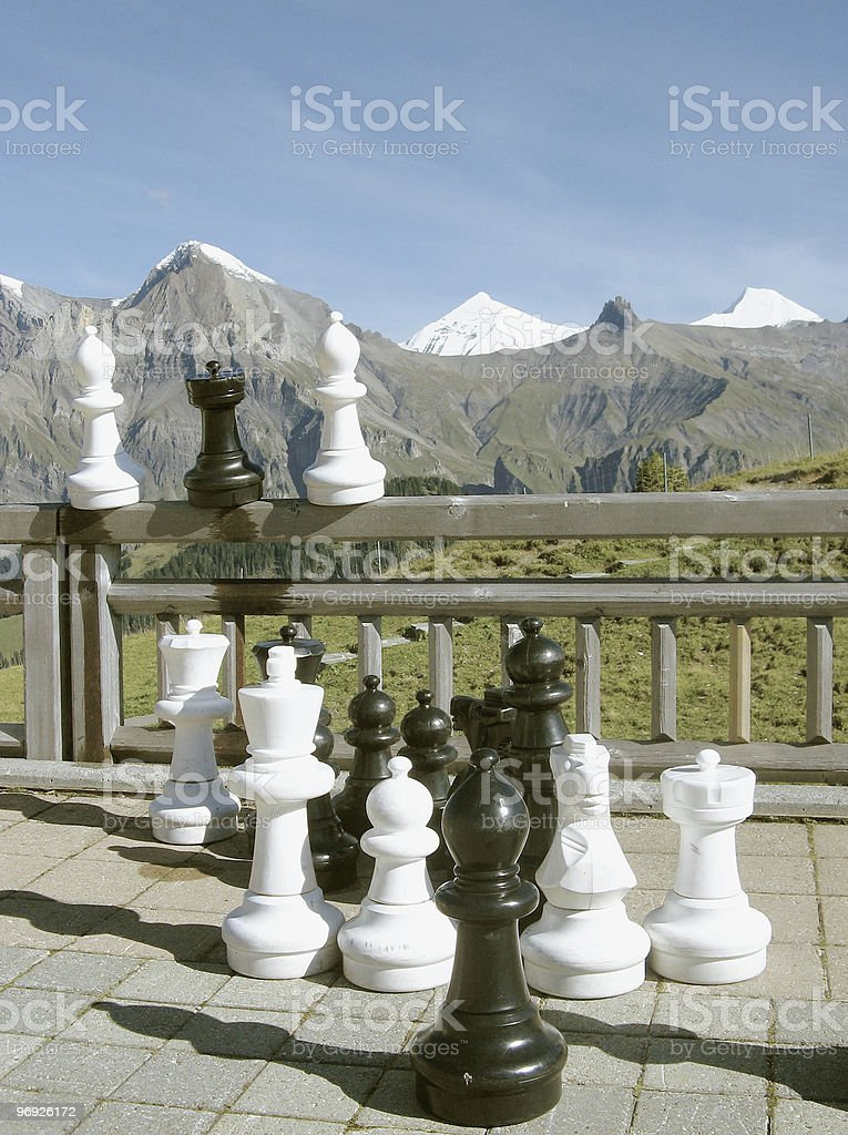 Concepts; Organized Chess Pieces and Mountain Range stock photo