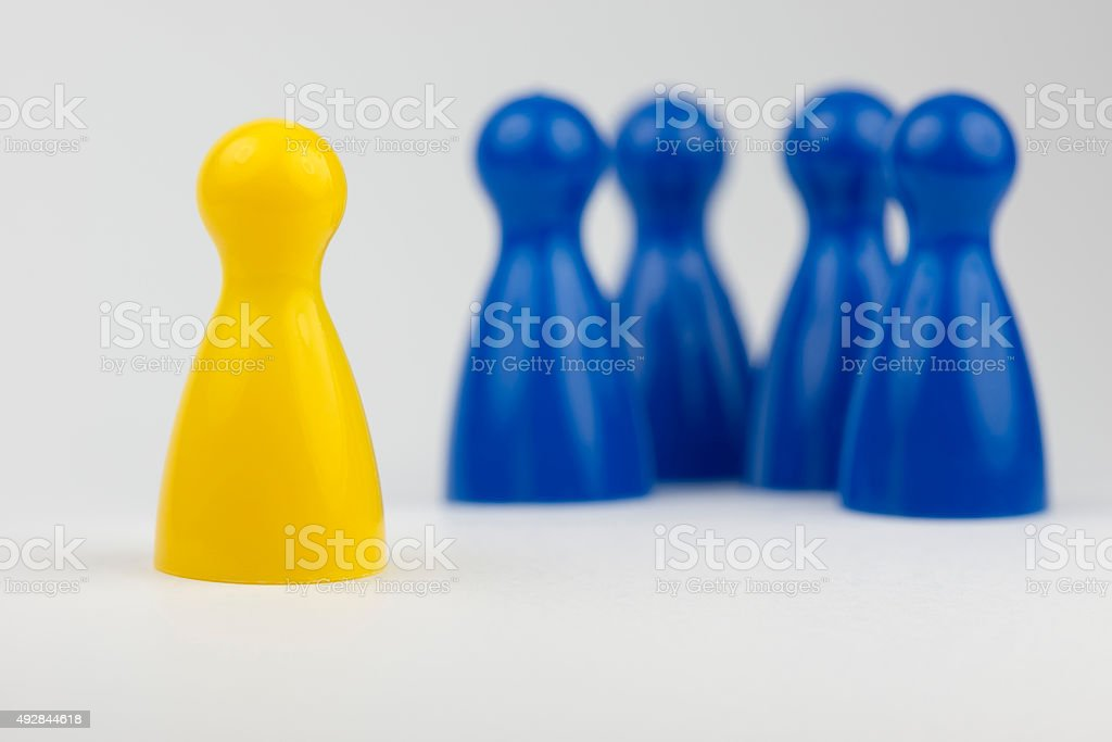 Conceptual game pawns. stock photo