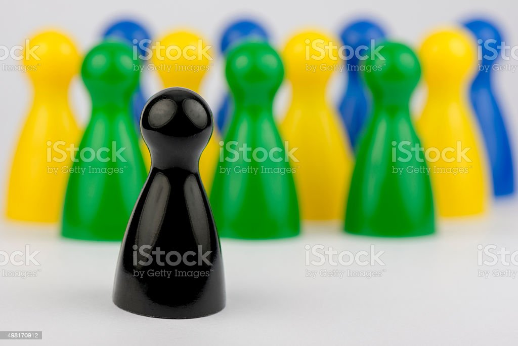 Conceptual game pawns stock photo
