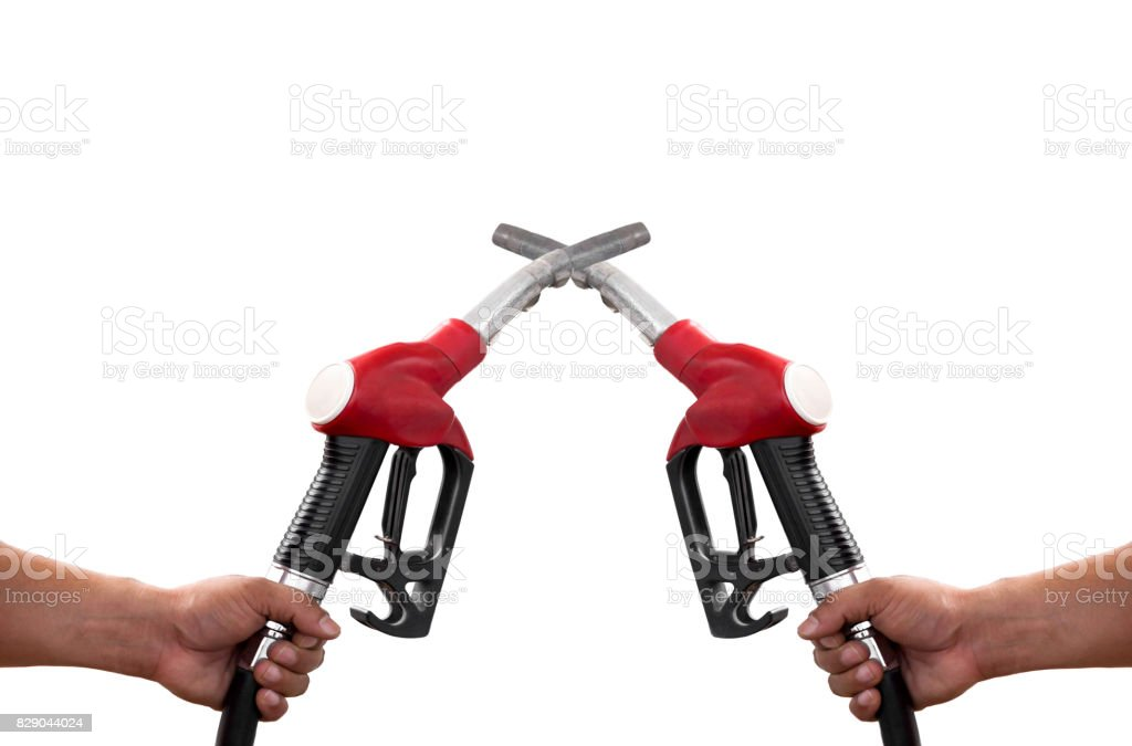 Conceptual Hands holding a fuel nozzle pump isolated stock photo