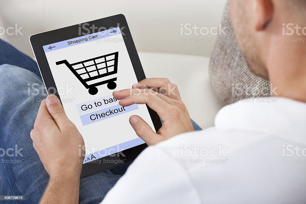 Conceptual image of a man making an online purchase stock photo
