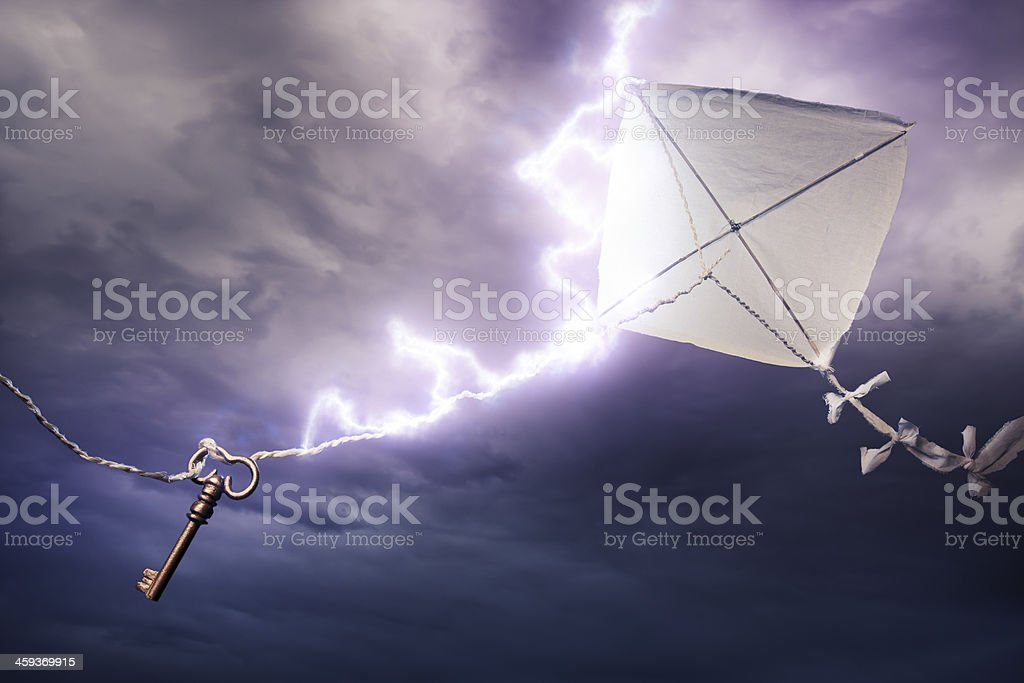 Conceptual image of kite with key being stuck by lightning stock photo