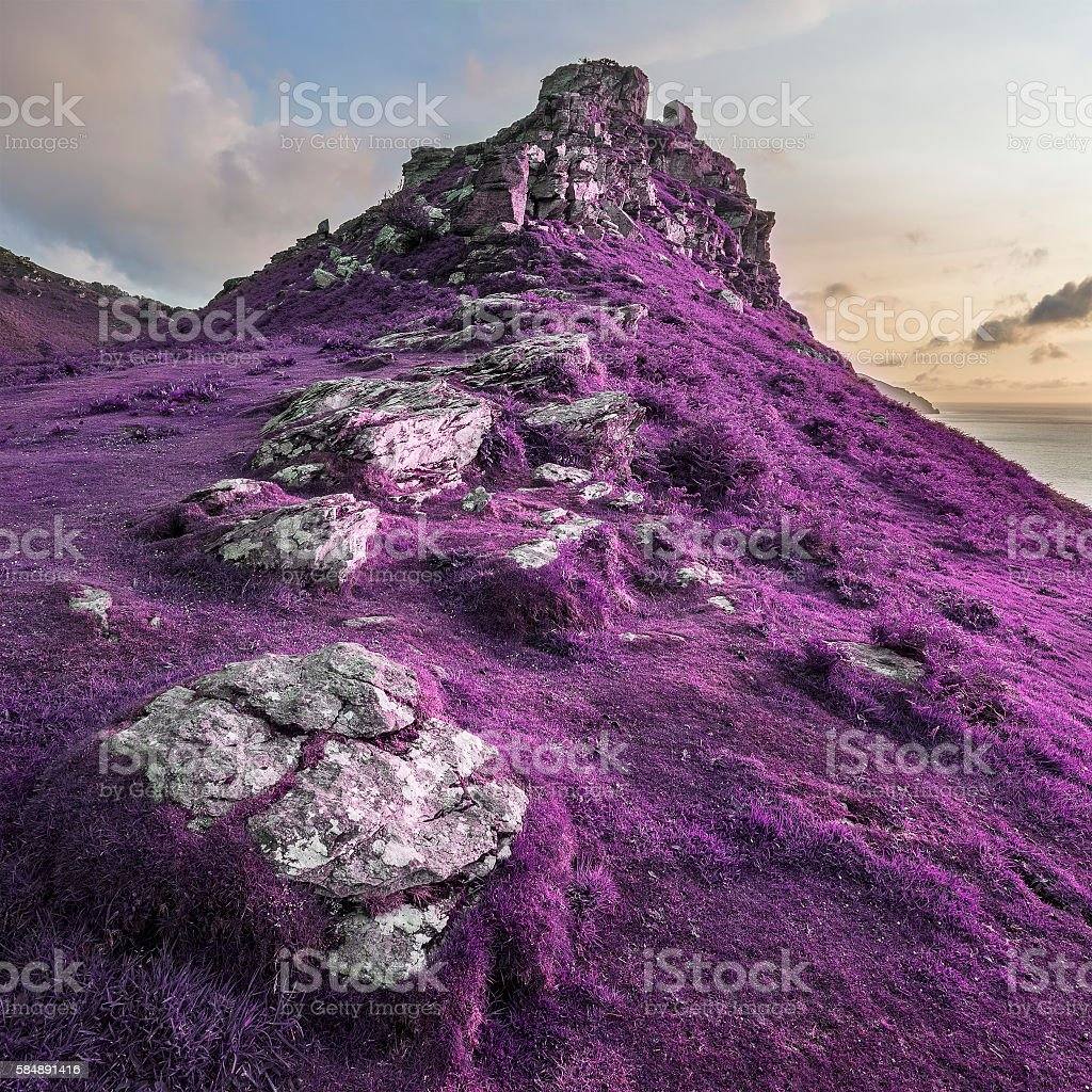 Conceptual image of surreal purple landscape at sunset stock photo