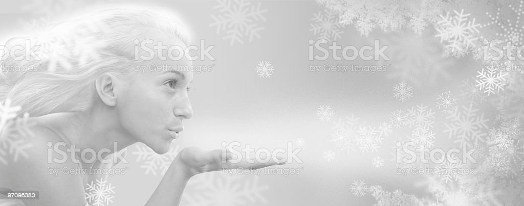 Conceptual image of winter goddess blowing cold snowflakes stock photo