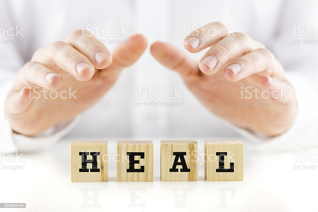 Conceptual image with the word Heal stock photo