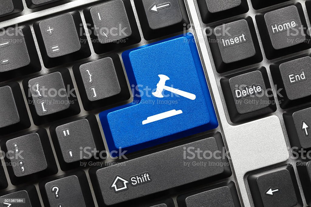 Conceptual keyboard - Blue key with gavel symbol stock photo