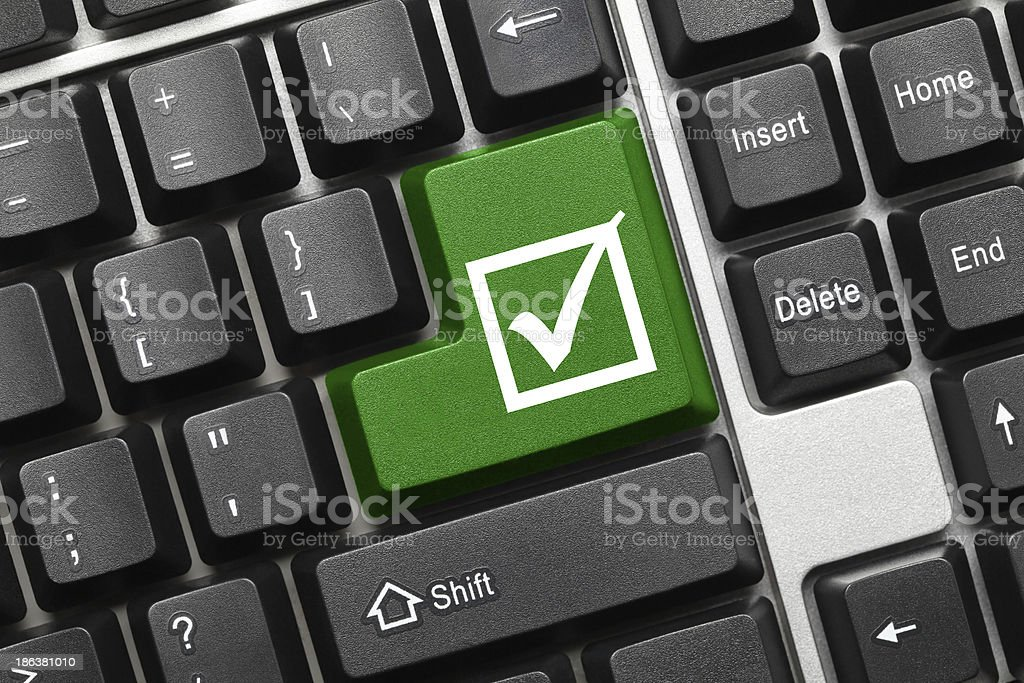 Conceptual keyboard - Checkbox with tick (green key) royalty-free stock photo