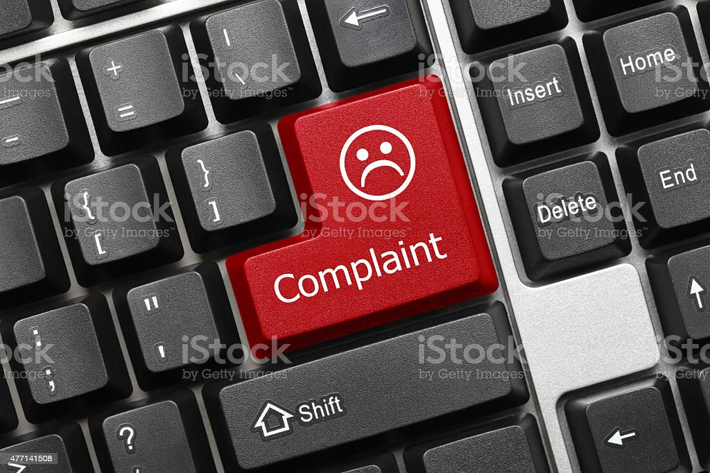 Conceptual keyboard - Complaint (red key) stock photo