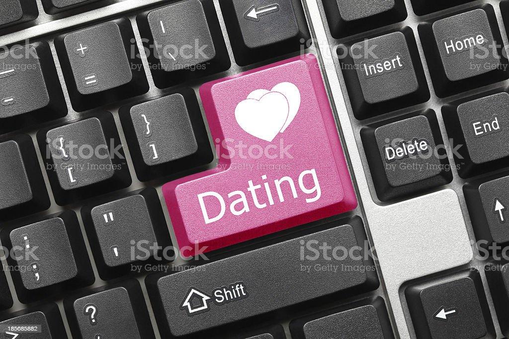 Conceptual keyboard - Dating (pink key) royalty-free stock photo