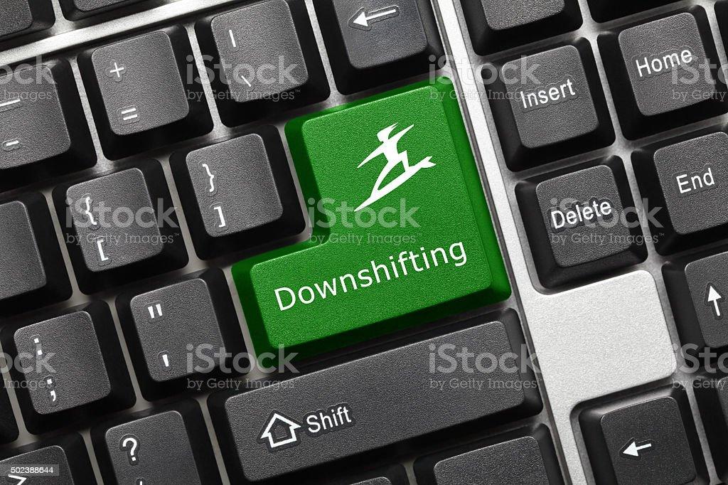 Conceptual keyboard - Downshifting (green key) stock photo