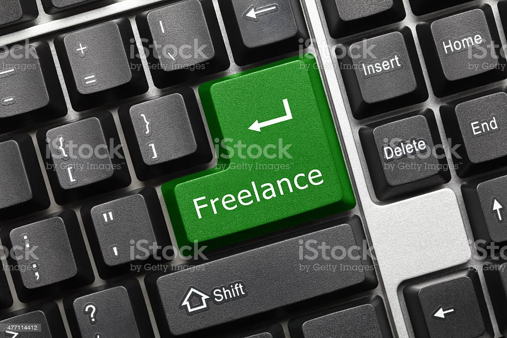 Conceptual keyboard - Freelance (green key) stock photo