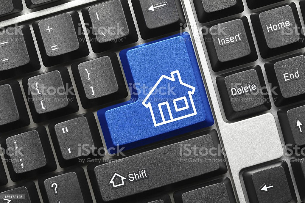 Conceptual keyboard - Home icon (blue key) royalty-free stock photo