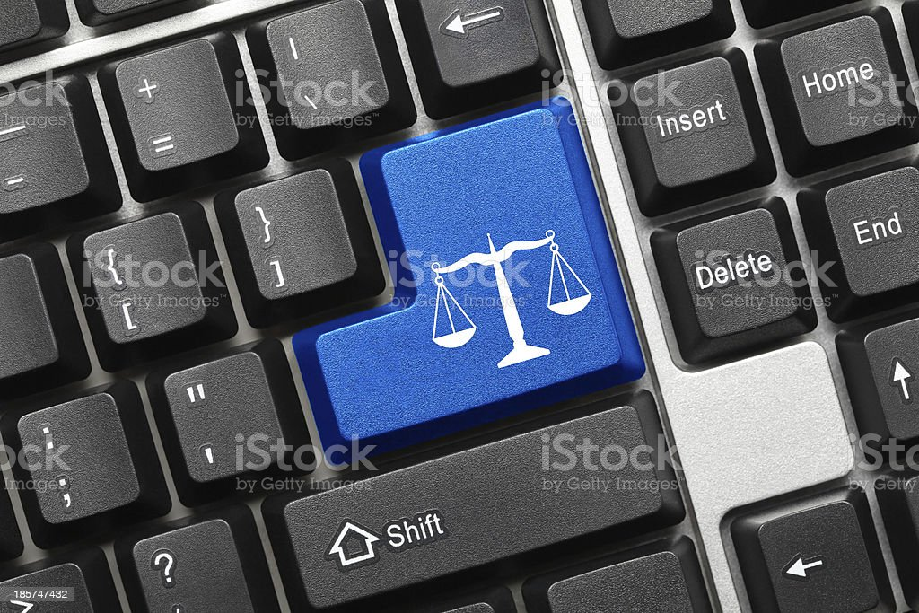 Conceptual keyboard - Law symbol (blue key) stock photo