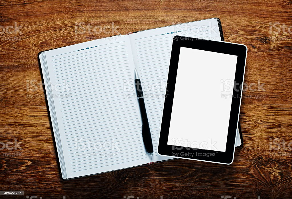 Conceptual Notes, Pen and Tablet on Wooden Table stock photo