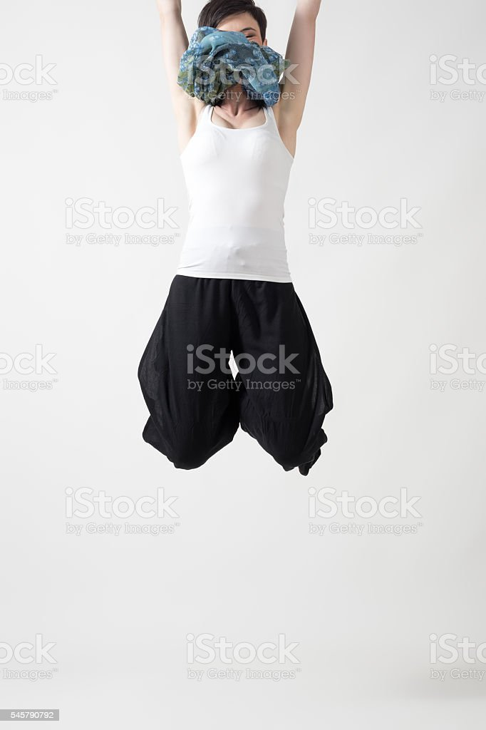 Conceptual photo of young woman jumping out of the frame stock photo