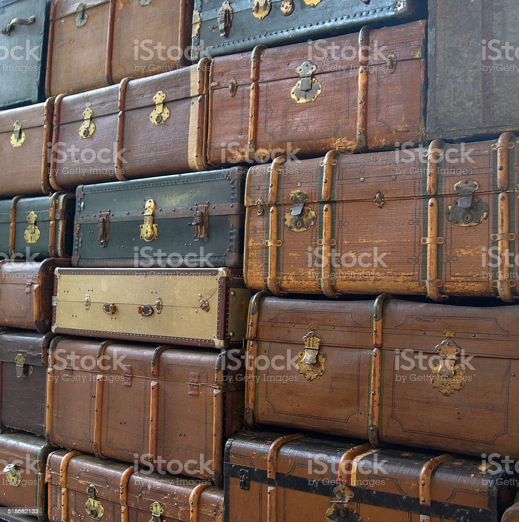 Conceptual picture of the wall with suitcases stock photo