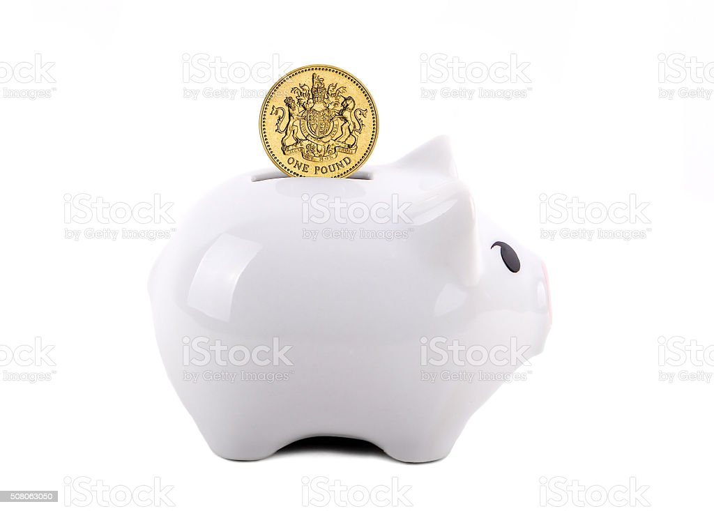 Conceptual Piggy Bank With Coin Deposit stock photo