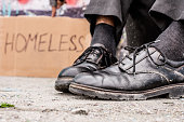 Conceptual shooting of poor man dirty shoes