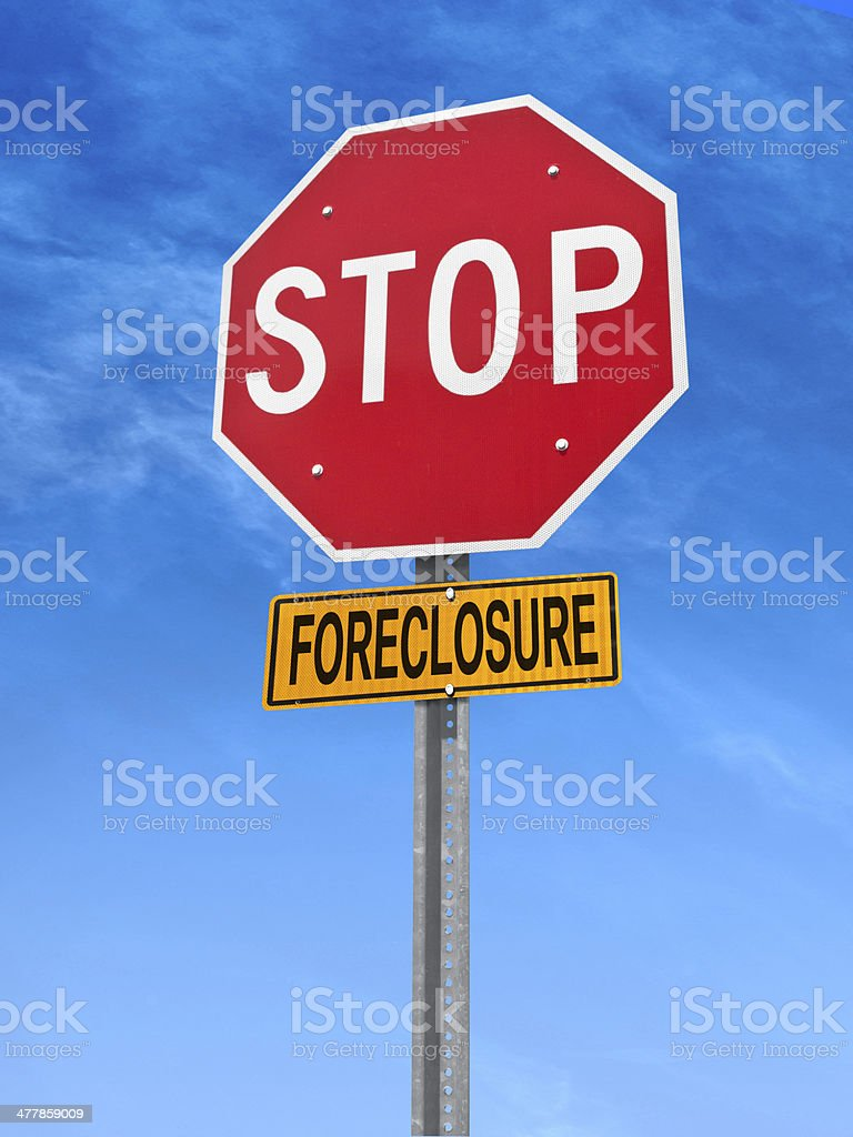 conceptual stop sign with word foreclosure stock photo