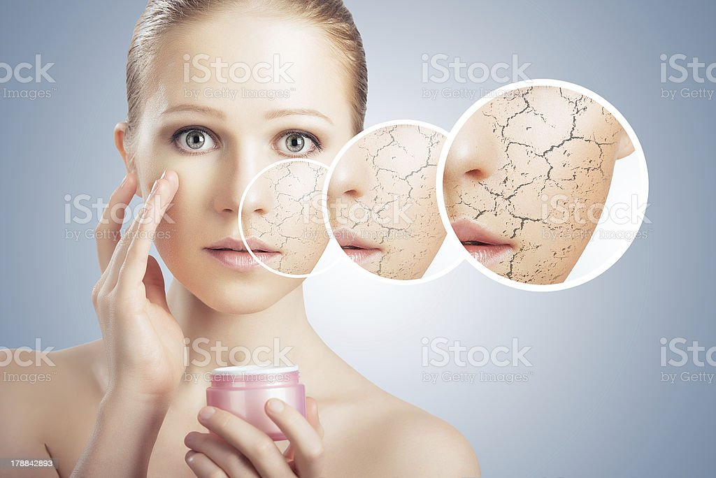 Conceptualized skincare on face of beautiful woman stock photo