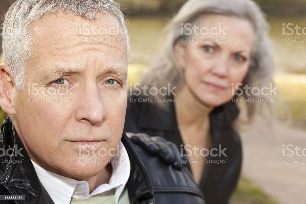 Concerned Adult Man With His Worried Wife royalty-free stock photo