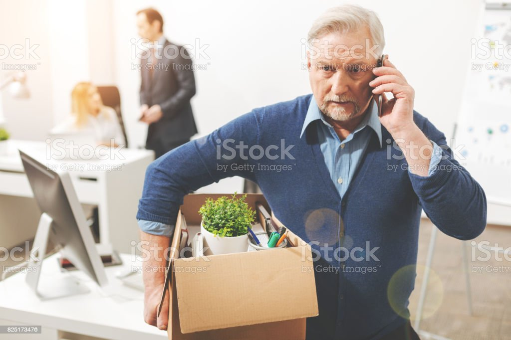 Concerned aged handsome man sharing the bad news stock photo