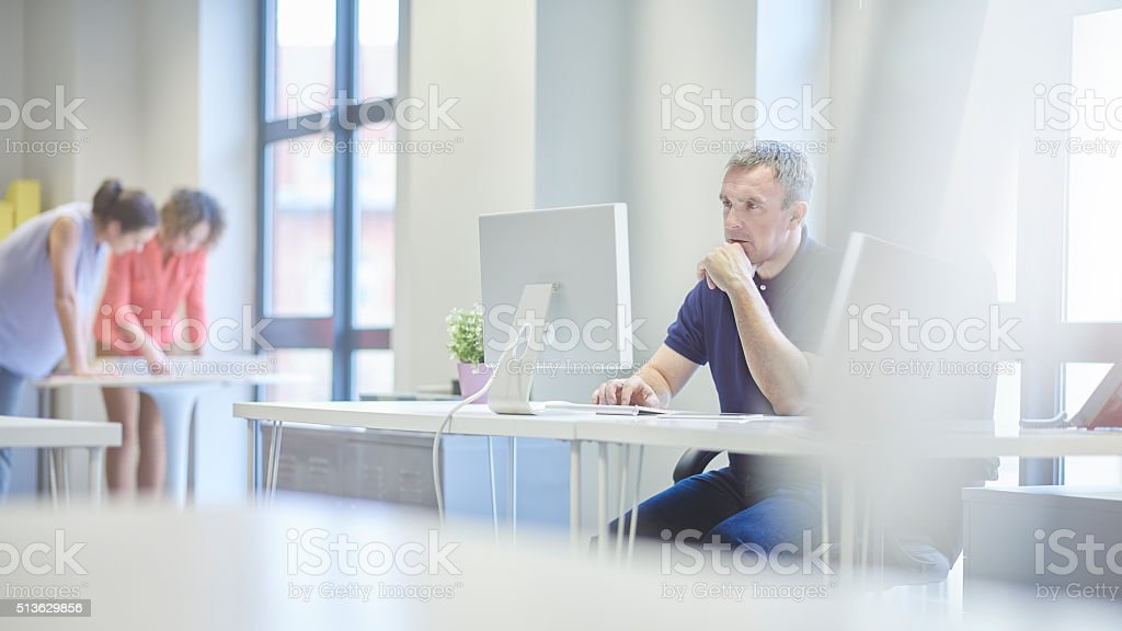 concerned businessman  in modern office stock photo