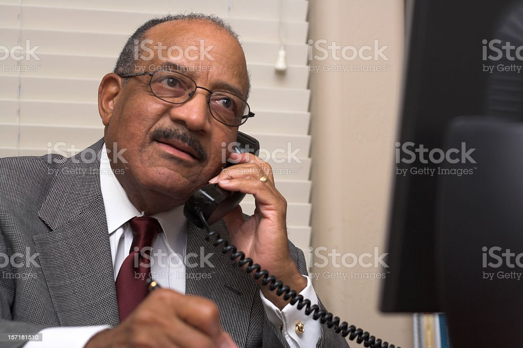Concerned businessman talking on a phone royalty-free stock photo