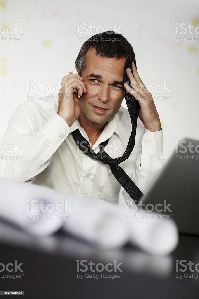 Concerned businessman talking on the cellphone royalty-free stock photo