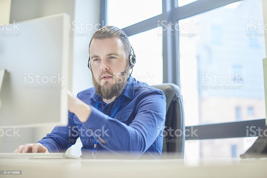 concerned call centre handler stock photo