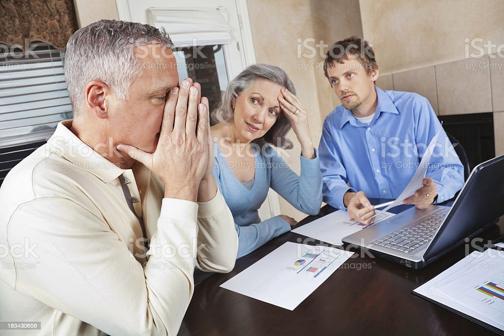 Concerned Couple in Meeting With Financial Advisor royalty-free stock photo