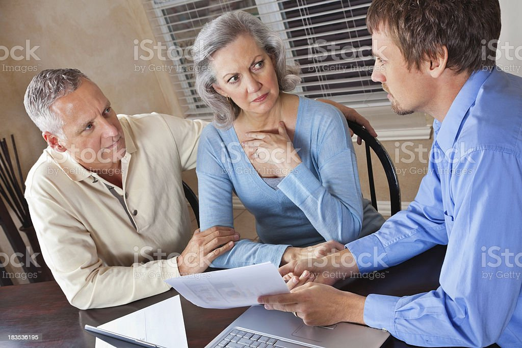 Concerned Couple Meeting With Financial Advisor royalty-free stock photo