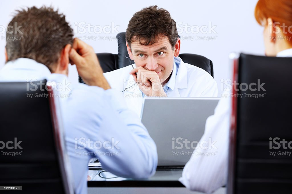 concerned Doctor delivering bad news to his patients royalty-free stock photo