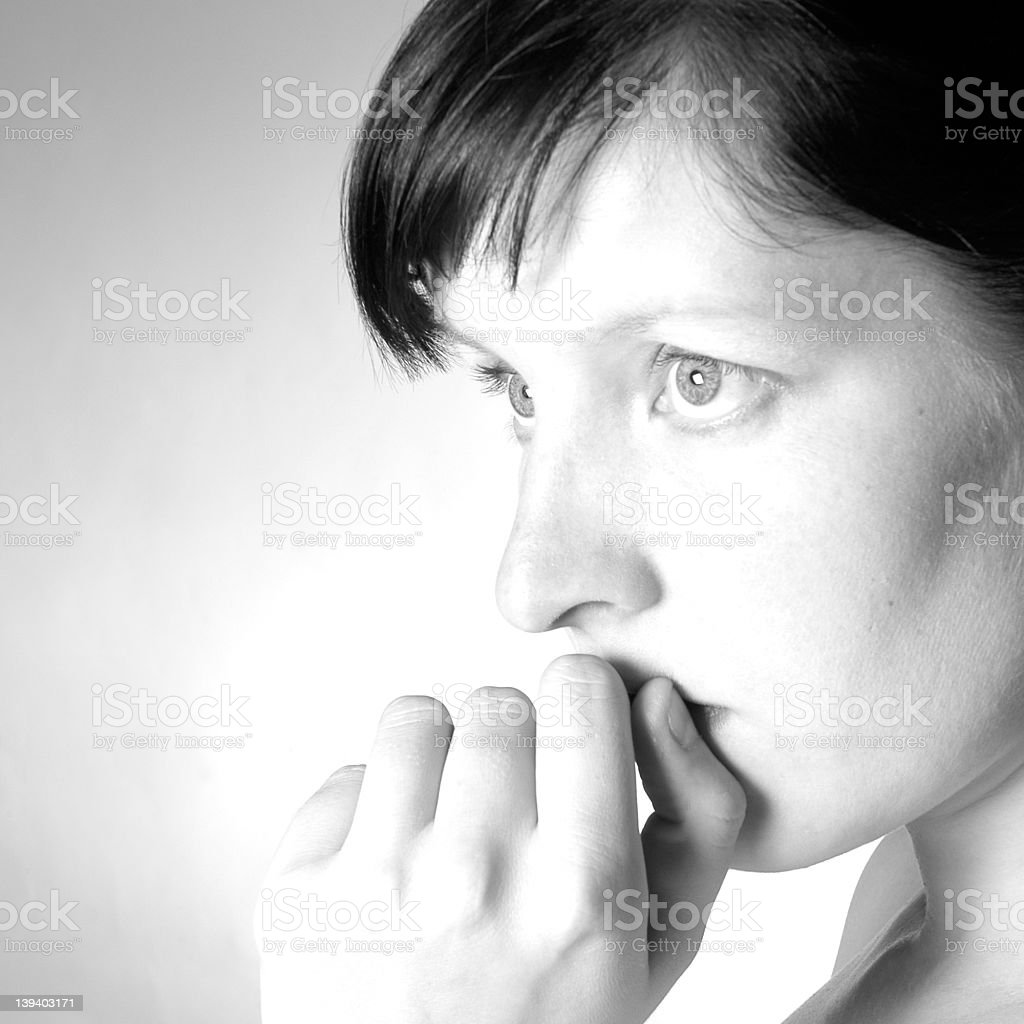 A concerned looking woman in black and white royalty-free stock photo