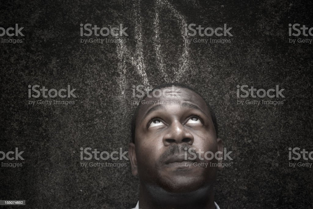 concerned man against dark wall with word no royalty-free stock photo