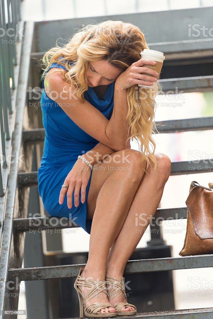 Concerned Mature blond woman stock photo