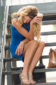 Concerned Mature blond woman