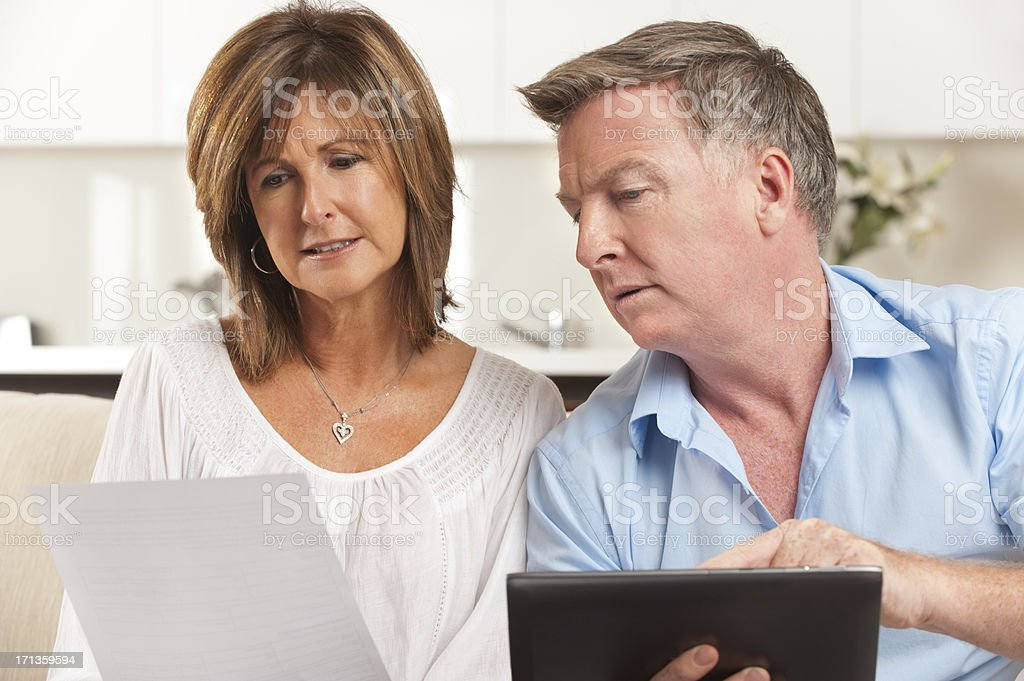 Concerned Mature couple paying bill online royalty-free stock photo