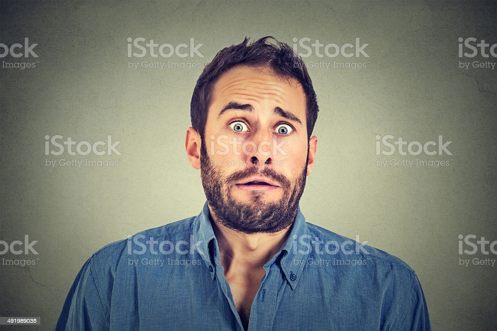Concerned scared man stock photo