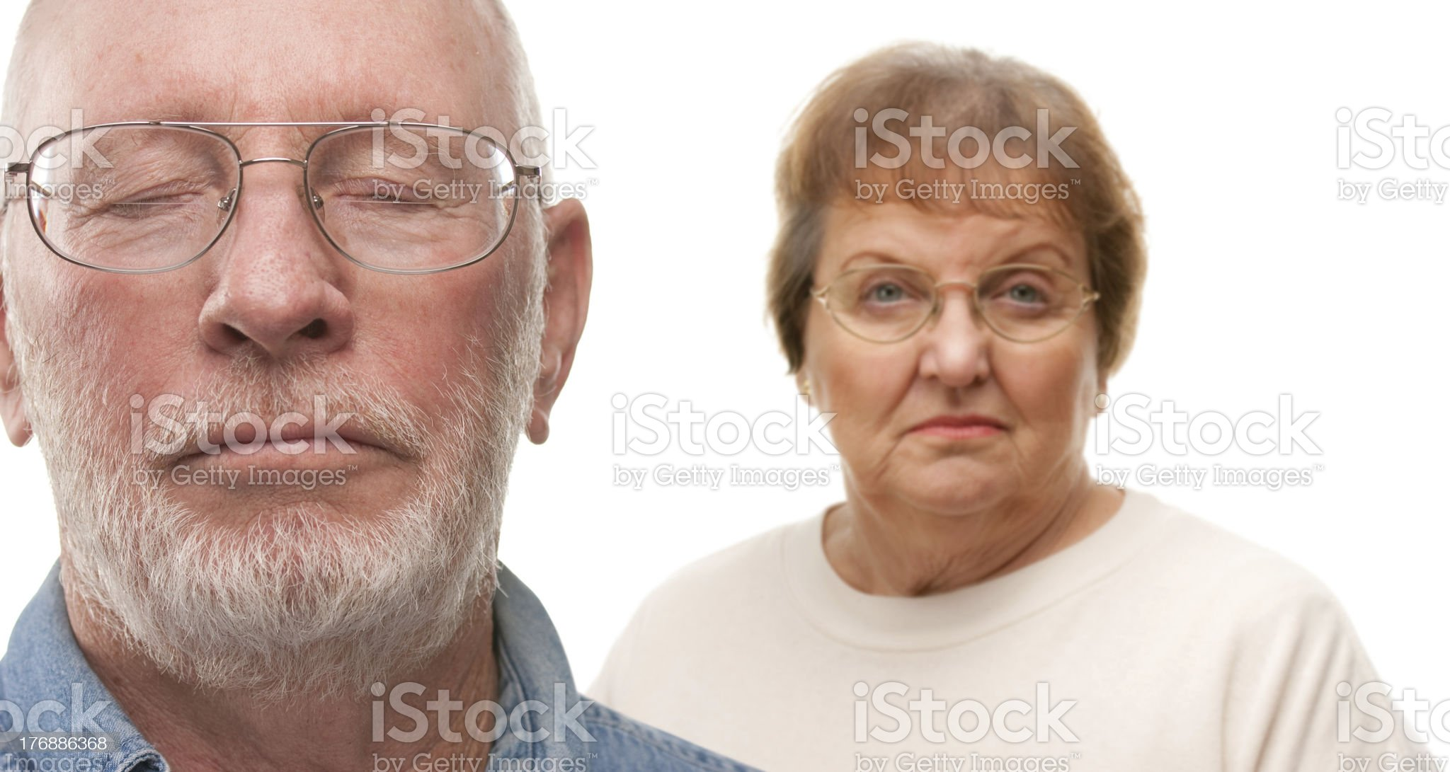 Concerned Senior Couple on White royalty-free stock photo