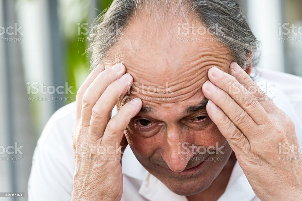 Concerned Senior Man stock photo