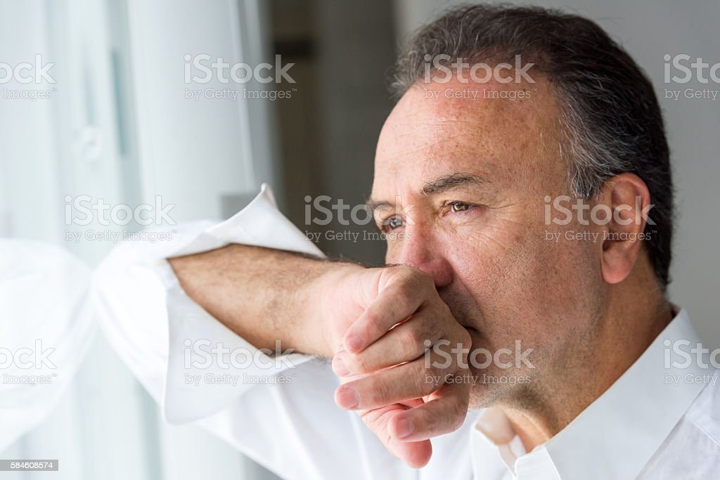 Concerned senior man stock photo