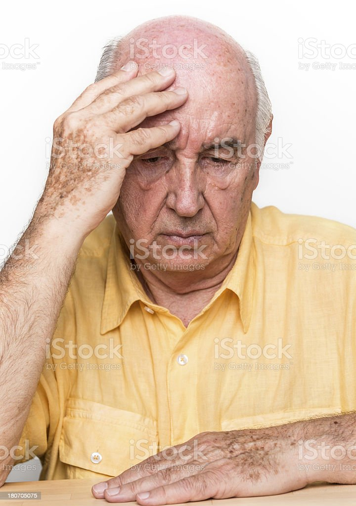 Concerned Senior Man with Hand on his Head royalty-free stock photo