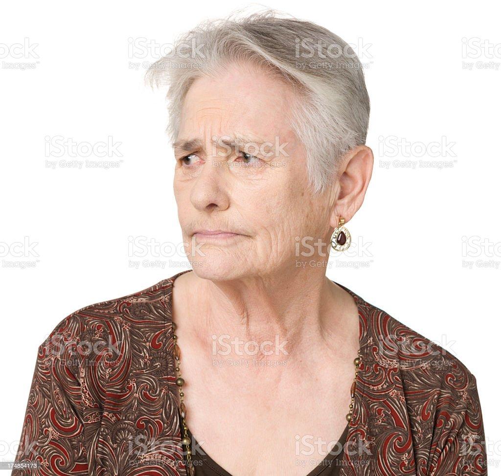 Concerned Senior Woman Looks Sideways royalty-free stock photo